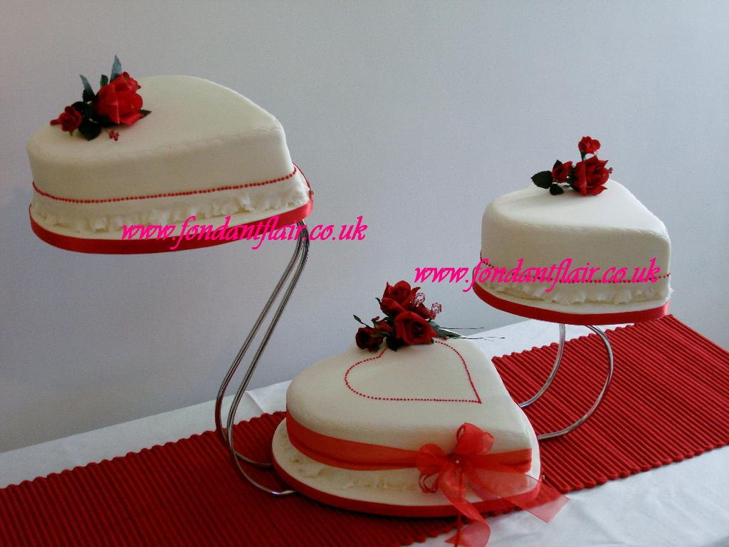 3 Tiered Celebration Cake with Ruby and Ivory decoration.  Fondant Flair, Colchester
