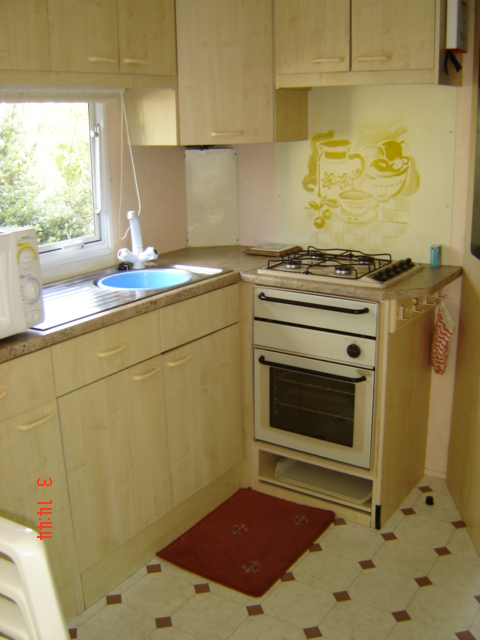 kitchen area in the above caravan mobile home
