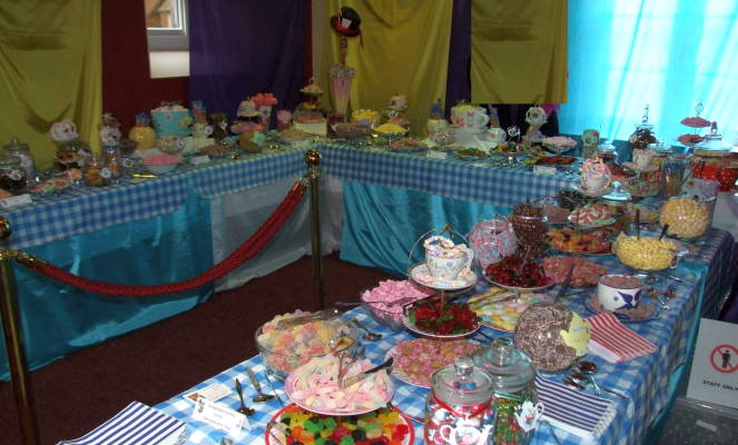 Sweets buffet table Oxford University, Mad Hatter's Tea Party theme for 1700 guests