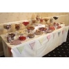 Wedding sweets buffet table Oakham with 24 varieties for 125 guests on an 8' table.