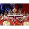 Candy buffet 2-tier centrepiece on a 12&#039; long table decorated in your colours.