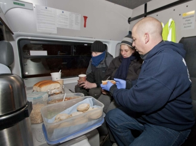 Chris Mounteney, Operations Manager of 'UK Homes 4 Heroes', prepares hot food, in a specially-equipped van, for 2 Northampton homeless.