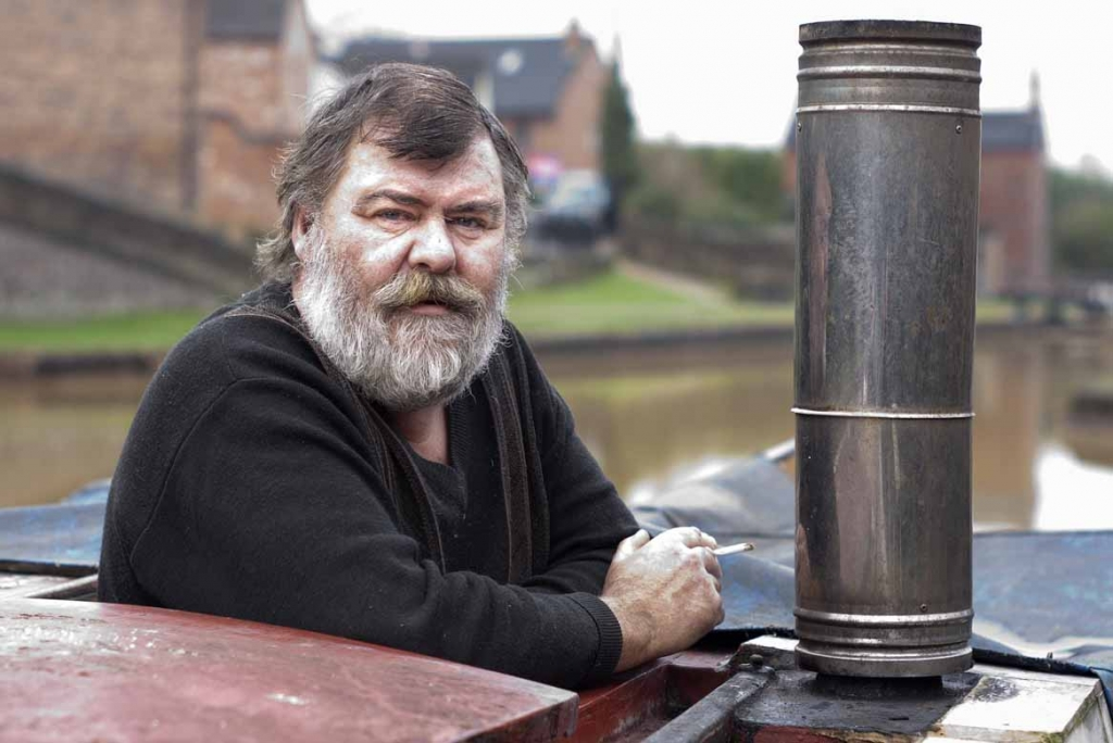 A narrowboat owner, on the Trent and Mersey Canal at Kidsgrove, on 9th February 2013.