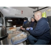 Chris Mounteney, Operations Director of UK Homes 4 Heroes, providing food and hot drinks to 2 homeless people in Northampton.