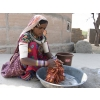Woman in traditional outfit, doing washing in village near Bhuj, Gujarat, India.