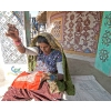 Woman in traditional outfit, doing needlework in village near Bhuj, Gujarat, India.