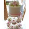 Vintage Rose and Bow Top cutting cake