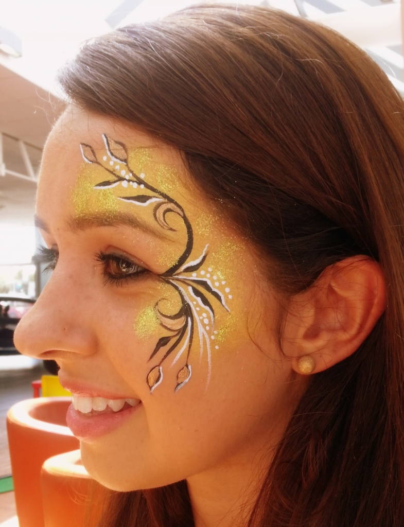 Black go black gold eye design for Face painting business